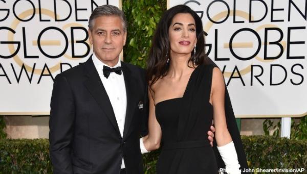 George Clooney com sua esposa Amal Amal (photo by John Shearer/ Invision/AP)