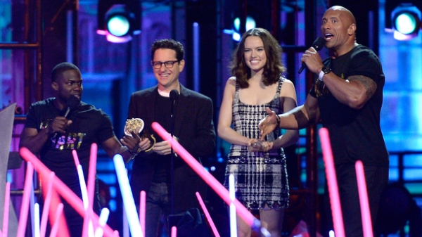 BURBANK, CALIFORNIA - APRIL 09: Writer/director J.J. Abrams and actress Daisy Ridley (both C) accept the Movie of the Year award for 'Star Wars: The Force Awakens' with co-hosts Kevin Hart (L) and Dwayne Johnson (R) onstage during the 2016 MTV Movie Awards at Warner Bros. Studios on April 9, 2016 in Burbank, California. MTV Movie Awards airs April 10, 2016 at 8pm ET/PT. (Photo by Kevork Djansezian/Getty Images)