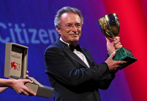 "Actor Oscar Martinez holds the Volpi Cup prize for best actor for the movie ""The Distinguished Citizen"" during the awards ceremony at the 73rd Venice Film Festival in Venice"