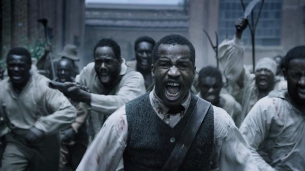 No centro, Nate Parker, o diretor e ator que protagoniza O Nascimento de uma Nação (photo by cine.gr)